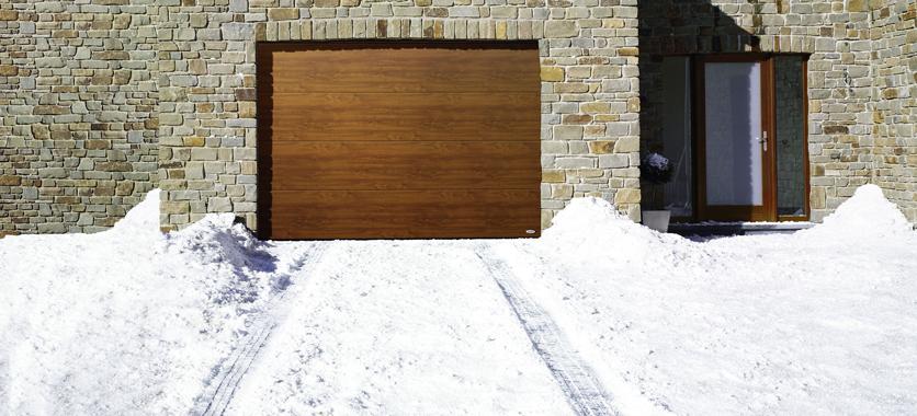 Novoferm podpowiada jak zadbać o bramę w zimowe dni